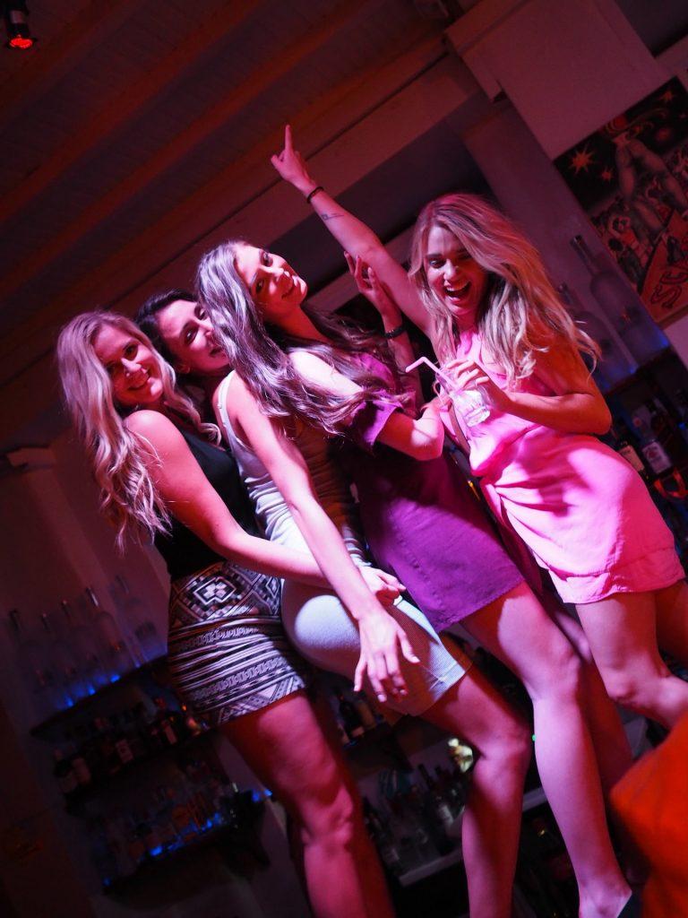 Four girls enjoying their group dance at the Skandinavian Bar & Disco in Mykonos